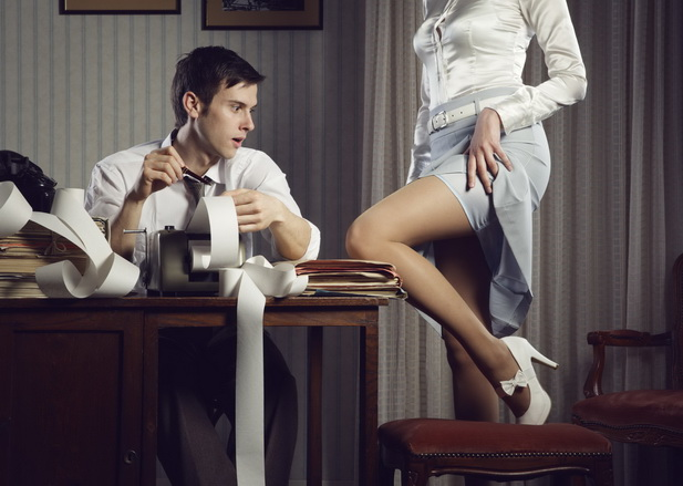 19287276 - young sexy woman shows a leg for business man at desk
